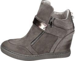 Damskie buty sneakersy na koturnie CARINII r 37 Ceny i