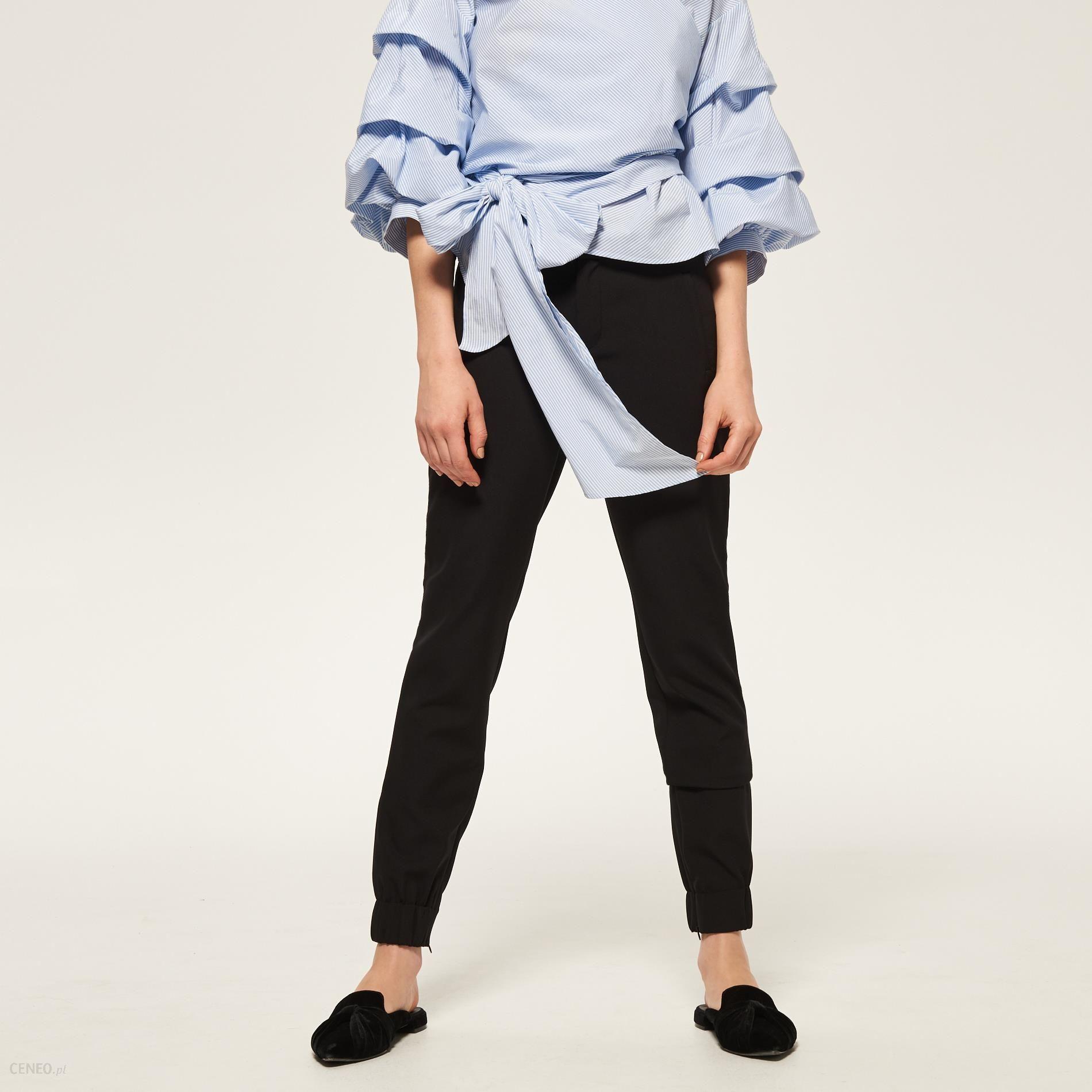 72d126869e9d8d Reserved - Eleganckie spodnie z elastyczną talią - Czarny - damski -  zdjęcie 1