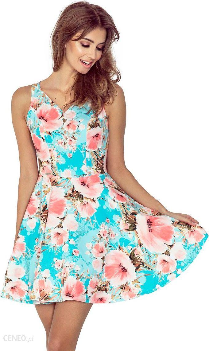 e264f8cd50 MM 014-1 Sukienka rozkloszowana - DEKOLT SERCE - KWIATY BRZOSKWINIOWE NA  NIEBIESKIM TLE -
