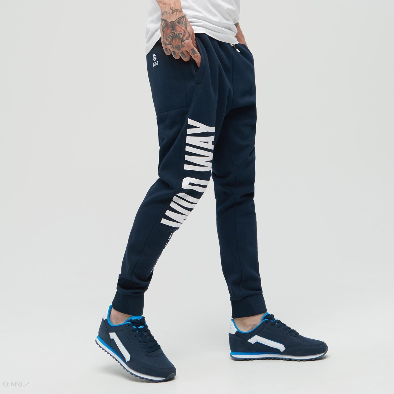 Cropp Dresowe spodnie typu jogger Granatowy Ceny i opinie Ceneo.pl