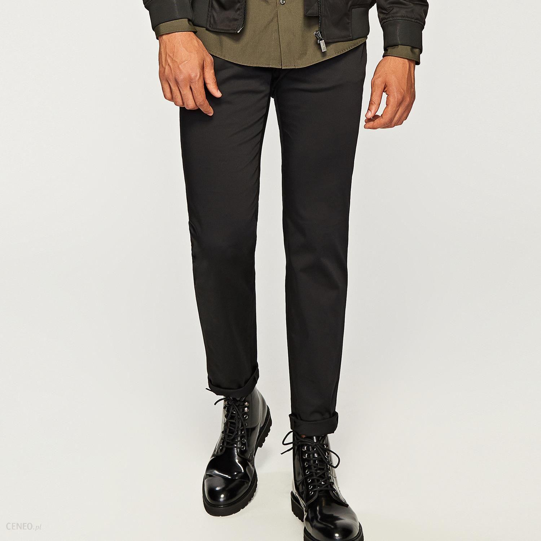 Reserved Materiałowe spodnie typu carrot Czarny