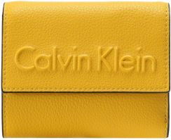 de631a145f2cd Calvin Klein EDGE MEDIUM TRIFOLD Portfel yellow - Ceny i opinie ...