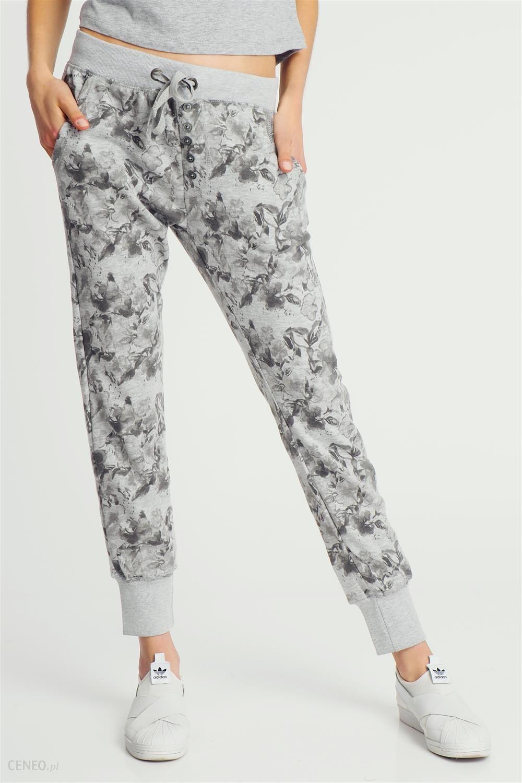 17c372b921991c Spodnie dresowe damskie baggy w kwiaty szare Sublevel - szary - zdjęcie 1