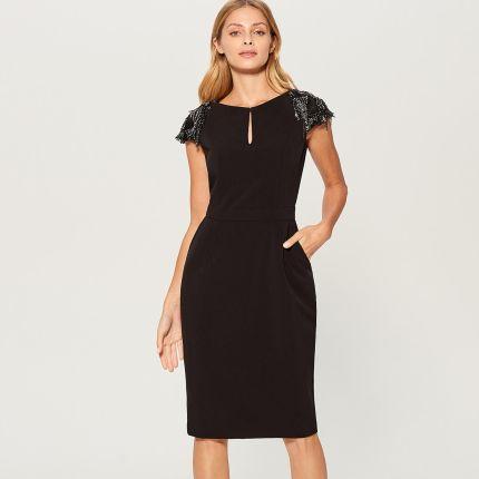 645661eb4a Mohito - Dopasowana sukienka z ozdobnymi rękawami - Czarny Mohito