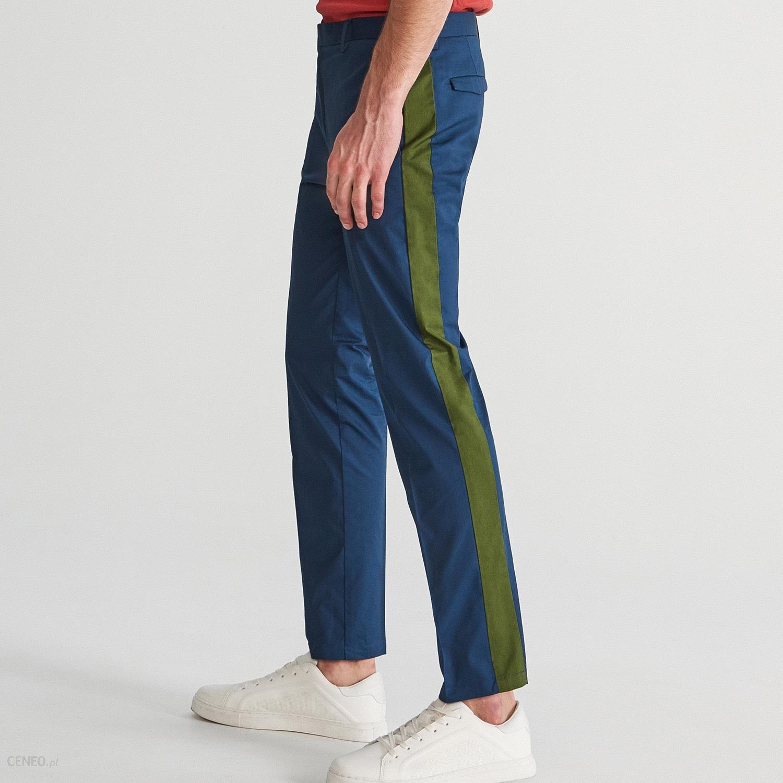 Reserved Spodnie chino z lampasami Granatowy Ceny i opinie Ceneo.pl