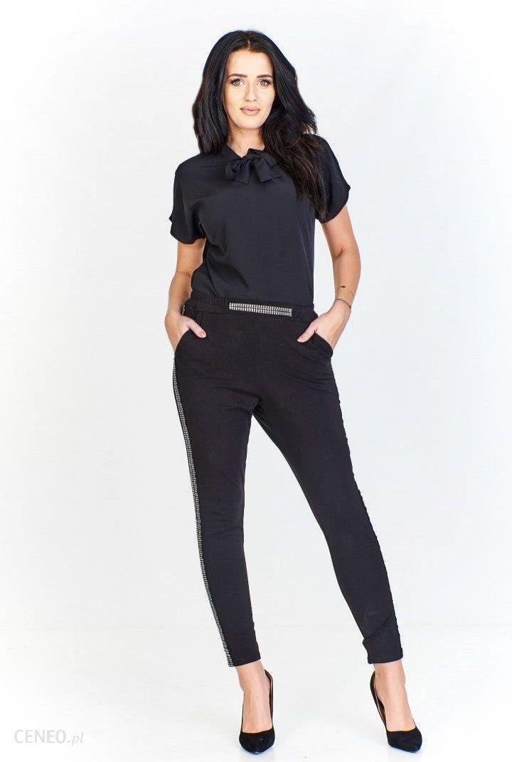 f37126cbb Spodnie w gumę z ozdobnymi dżetami po bokach oraz przy pasie i na  kieszeniach - zdjęcie