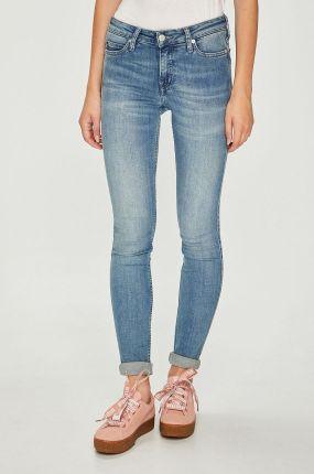 84a67bfdcea00 Granatowe spodnie jeansowe z lampasem oraz ozdobnymi zamkami Olika ...