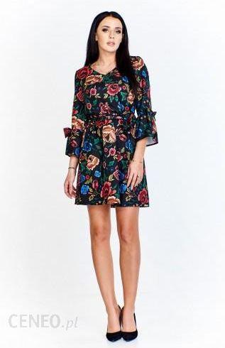 95d24c3fb3 Sukienka w kwiatowy wzór wiązana w pasie z rękawami 3 4 wykończonymi  rozkloszowaniem z kokardką