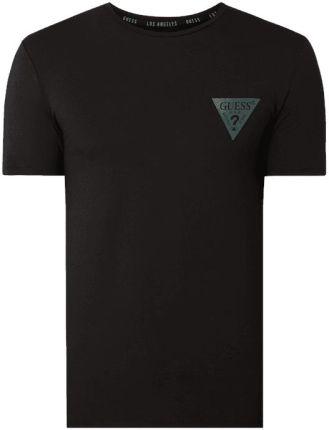 011df02cf Guess T-shirt o kroju super slim fit z nadrukiem z logo Peek & Cloppenburg. Koszulka  męska ...