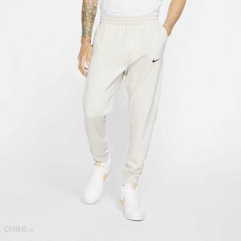 Nike Męskie spodnie z dzianiny Nike Sportswear Tech Pack Kremowy Ceny i opinie Ceneo.pl