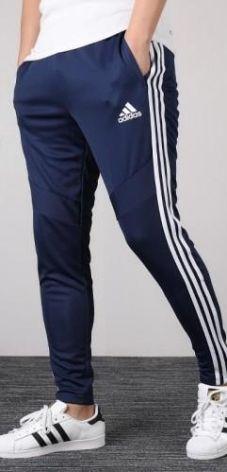 84a0ac992 Spodnie Adidas dresy rurki zwężane granatowe 24H DT5174